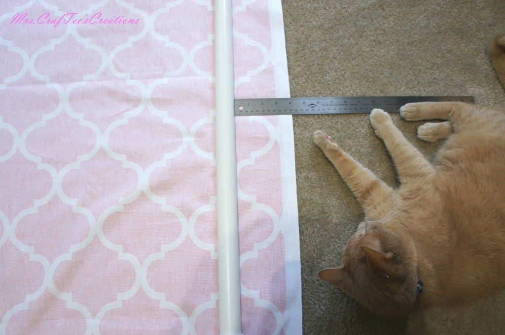 "Measure ~ 5"" from the frame to the end of the fabric on all sides. This will vary depending on the width of your PVC. Mark this measurement and make another mark about 1"" from the edge of the fabric"