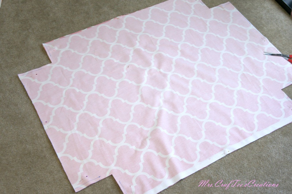 Cut out the squares you just made on the corners. The fabric should look like this.