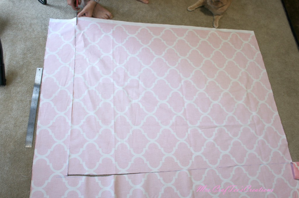 Cut a square out of the fabric larger than the frame.